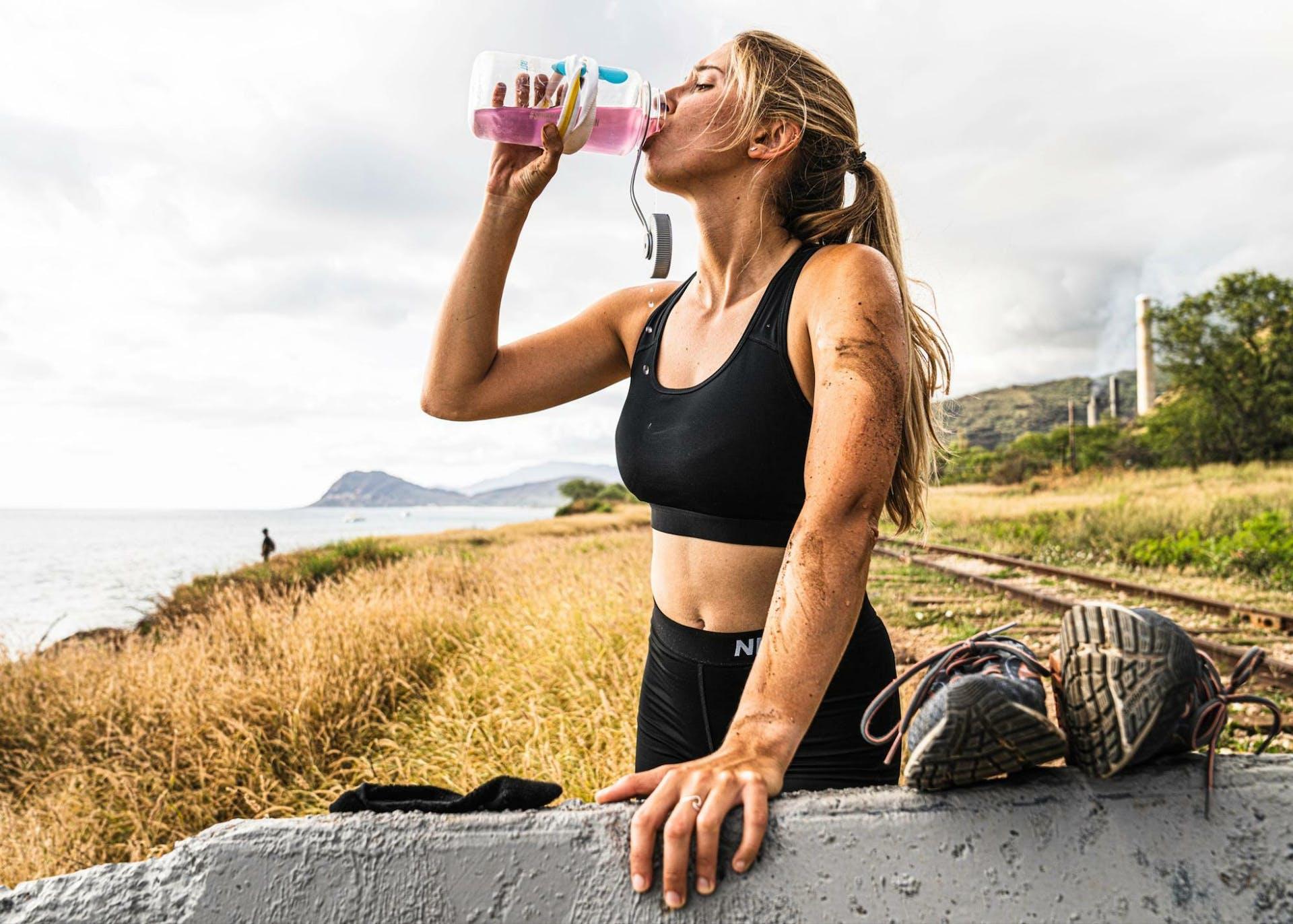 Woman drinking in her Drip Drop ORS bottle